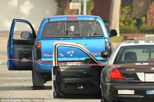 Police shot this truck 102 times without provocation in the Dorner manhunt.  (Source: LA Times)