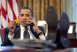 Obama with his feet on the Oval Office desk