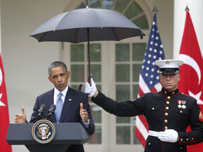 Marine holds umbrella